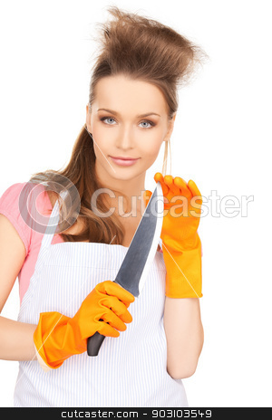 housewife with big knife stock photo, picture of beautiful housewife with big knife by Syda Productions