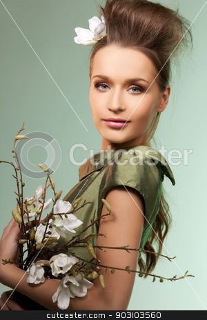 beautiful woman stock photo, picture of beautiful woman over green background by Syda Productions