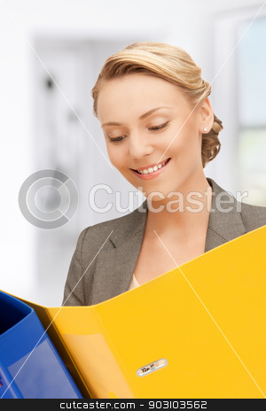 smiling woman with folders stock photo, bright picture of smiling woman with folders by Syda Productions