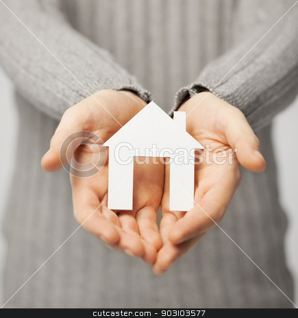 man holding paper house stock photo, bright picture of man holding paper house by Syda Productions