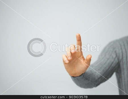 man pressing imaginary button stock photo, bright picture of man pressing imaginary button by Syda Productions
