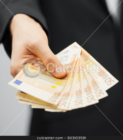 man in suit with euro cash money stock photo, picture of man in suit with euro cash money. by Syda Productions