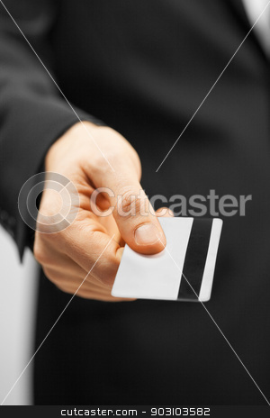 man in suit holding credit card stock photo, picture of man in suit holding credit card. by Syda Productions