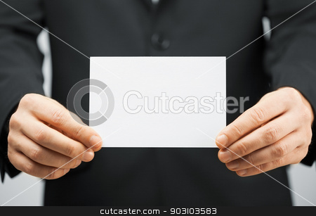 man in suit holding blank card stock photo, picture of man in suit holding blank card. by Syda Productions