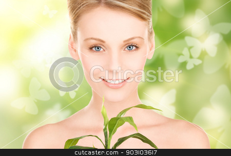 woman with sprout and butterflies stock photo, woman with sprout and butterflies over green background by Syda Productions
