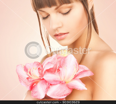lovely woman with red lily flower stock photo, bright picture of lovely woman with red lily flower by Syda Productions