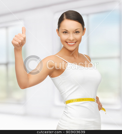 woman with measuring tape stock photo, picture of beautiful woman with measuring tape by Syda Productions