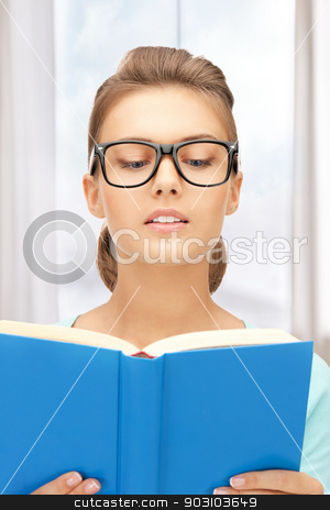 calm and serious woman with book stock photo, bright picture of calm and serious woman with book by Syda Productions
