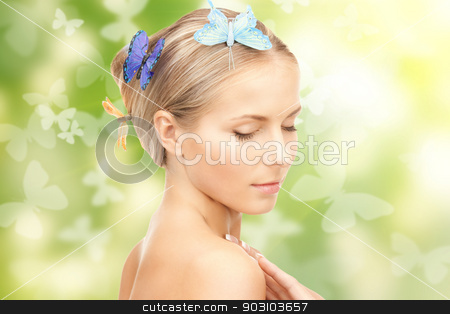 beautiful woman with butterfly in hair stock photo, picture of beautiful woman with butterfly in hair by Syda Productions