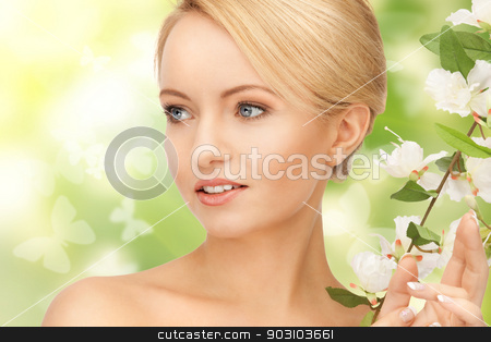 beautiful woman with flowers on twig stock photo, picture of beautiful woman with flowers on twig by Syda Productions