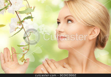 woman with flowers on twig and butterflies stock photo, beautiful woman with flowers on twig and butterflies by Syda Productions