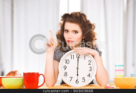 young attractive woman in the kitchen stock photo, picture of young attractive woman in the kitchen by Syda Productions