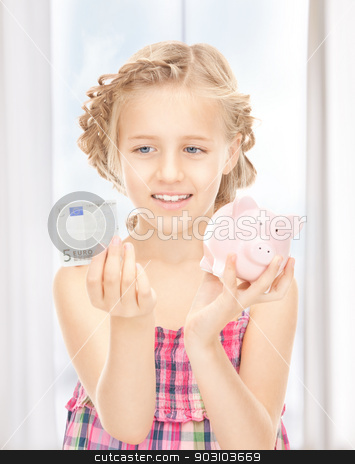 little girl with piggy bank and money stock photo, picture of little girl with piggy bank and money by Syda Productions