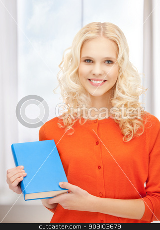 happy and smiling woman with book stock photo, bright picture of happy and smiling woman with book by Syda Productions