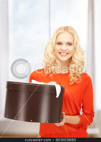 happy teenage girl with gift box stock photo, picture of happy teenage girl with gift box by Syda Productions
