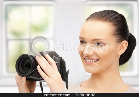 teenage girl with digital camera stock photo, picture of happy teenage girl with digital camera by Syda Productions