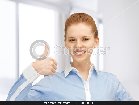 thumbs up stock photo, bright picture of young woman with thumbs up by Syda Productions