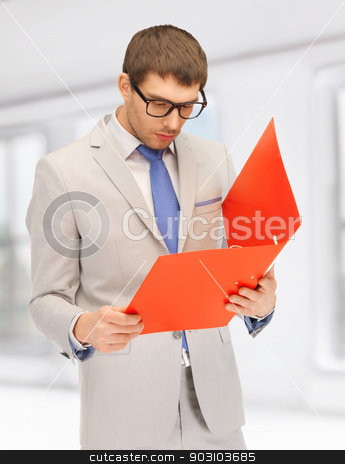 man with folders stock photo, bright picture of handsome man with folders by Syda Productions