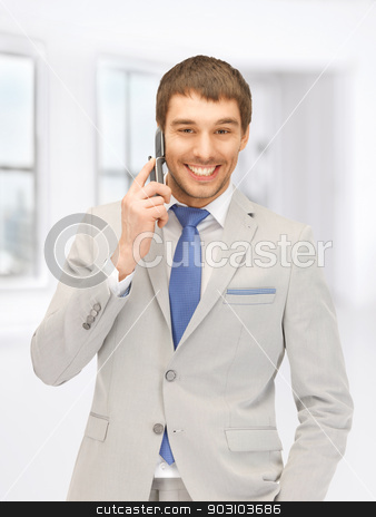handsome man with cell phone stock photo, picture of handsome man with cell phone by Syda Productions