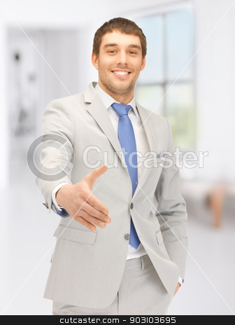 man with an open hand ready for handshake stock photo, handsome man with an open hand ready for handshake by Syda Productions