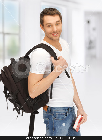 travelling student stock photo, bright picture of travelling student with backpack and book by Syda Productions