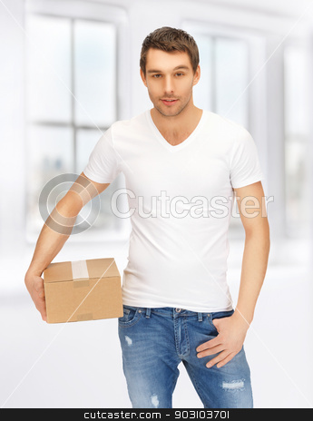 man in white shirt with parsel stock photo, handsome man in white shirt with parsel by Syda Productions