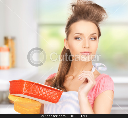 beautiful cooking housewife stock photo, picture of beautiful cooking housewife in kitchen by Syda Productions