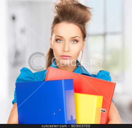 serious woman with folders stock photo, bright picture of serious woman with folders by Syda Productions