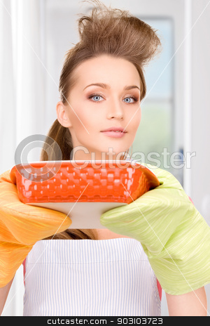 cooking housewife stock photo, picture of beautiful cooking housewife at home by Syda Productions