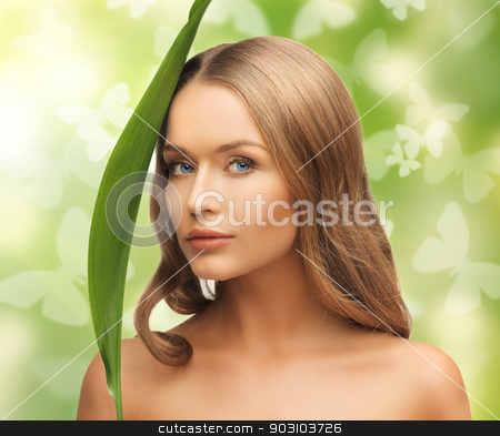 woman with green leaf and butterflies stock photo, picture of happy woman with green leaf and butterflies by Syda Productions