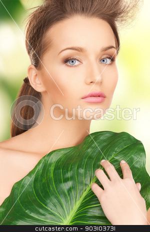 woman with green leaf stock photo, picture of beautiful woman with green leaf by Syda Productions