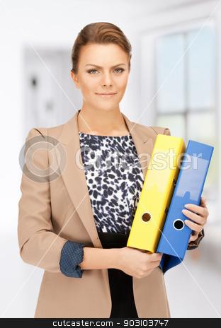 beautiful woman with folders stock photo, bright picture of beautiful woman with folders by Syda Productions