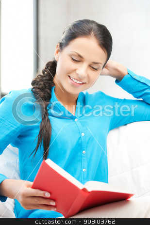 happy and smiling woman with book stock photo, bright picture of happy and smiling woman with book.. by Syda Productions