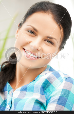 picture of smiling woman at home stock photo, bright closeup picture of smiling woman at home by Syda Productions