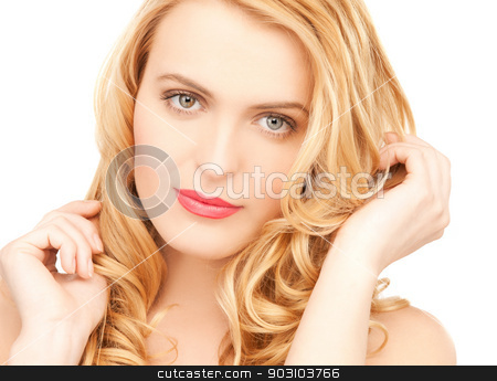 beautiful woman playing with long hair stock photo, picture of beautiful woman playing with long hair by Syda Productions