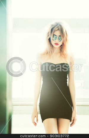 girl in sunglasses posing in elevator stock photo, picture of girl in sunglasses posing in elevator by Syda Productions