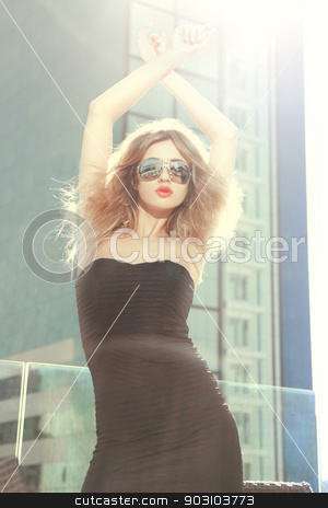 top model posing outside with sunglasses stock photo, fashion top model posing outside with sunglasses by Syda Productions