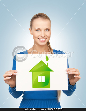 woman with illustration of green eco house stock photo, woman holding paper with illustration of green eco house by Syda Productions
