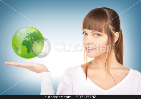 woman holding green globe on her hand stock photo, picture of woman holding green globe on her hand by Syda Productions
