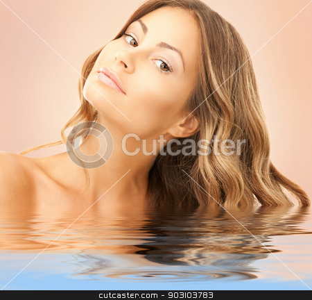 lovely woman stock photo, bright picture of lovely woman over beige by Syda Productions