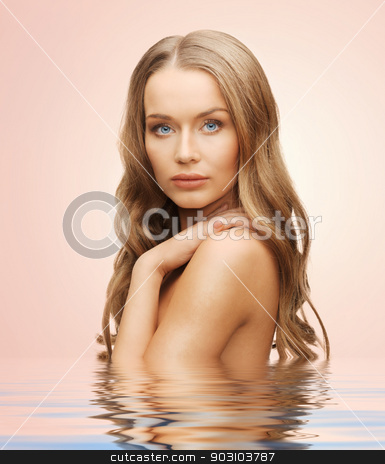 beautiful woman with long hair stock photo, beautiful woman with long hair in water by Syda Productions