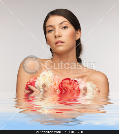 relaxed woman with flowers stock photo, bright picture of relaxed woman with flowers by Syda Productions