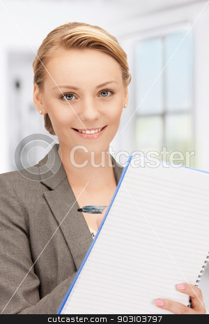 happy woman with big notepad stock photo, picture of happy woman with big notepad by Syda Productions