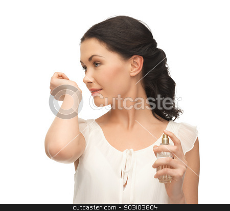 woman smelling perfume on her hand stock photo, picture of beautiful woman smelling perfume on her hand by Syda Productions