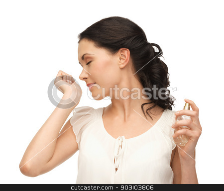 beautiful woman with long hair stock photo, picture of beautiful woman smelling perfume on her hand by Syda Productions
