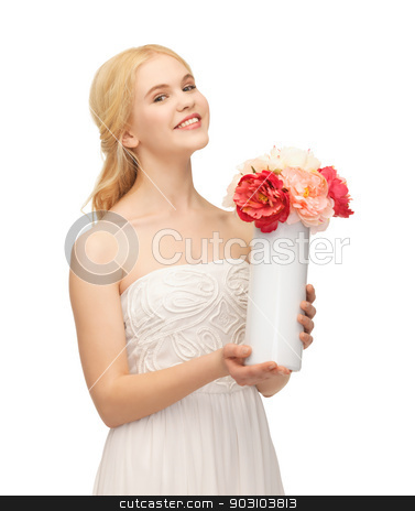 woman with vase of flowers stock photo, picture of young and beautiful woman with vase of flowers by Syda Productions