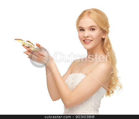 woman with butterfly in hand stock photo, picture of beautiful woman with butterfly in hand by Syda Productions