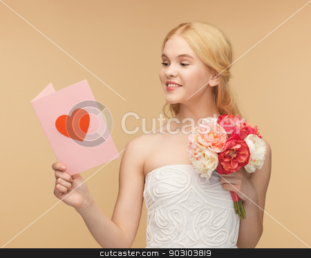 young woman holding flower and postcard stock photo, picture of young woman holding flower and postcard by Syda Productions
