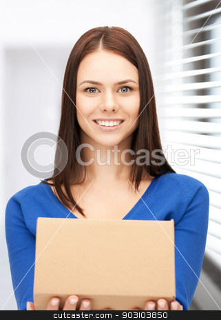 attractive businesswoman with cardboard box stock photo, picture of attractive businesswoman with cardboard box by Syda Productions