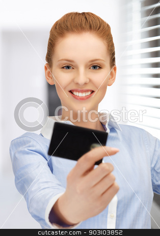 happy woman with credit card stock photo, bright picture of happy woman with credit card by Syda Productions